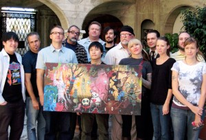 Last years artists with their collaborative painting.  Gary Baseman, Tim Biskup, Luke Chueh, Gris Grimly, James Jean, Frank Kozik, Lola, Tara McPherson, Ragnar, Jeffery Scott (1019), Jeff Soto and Amanda Visell.