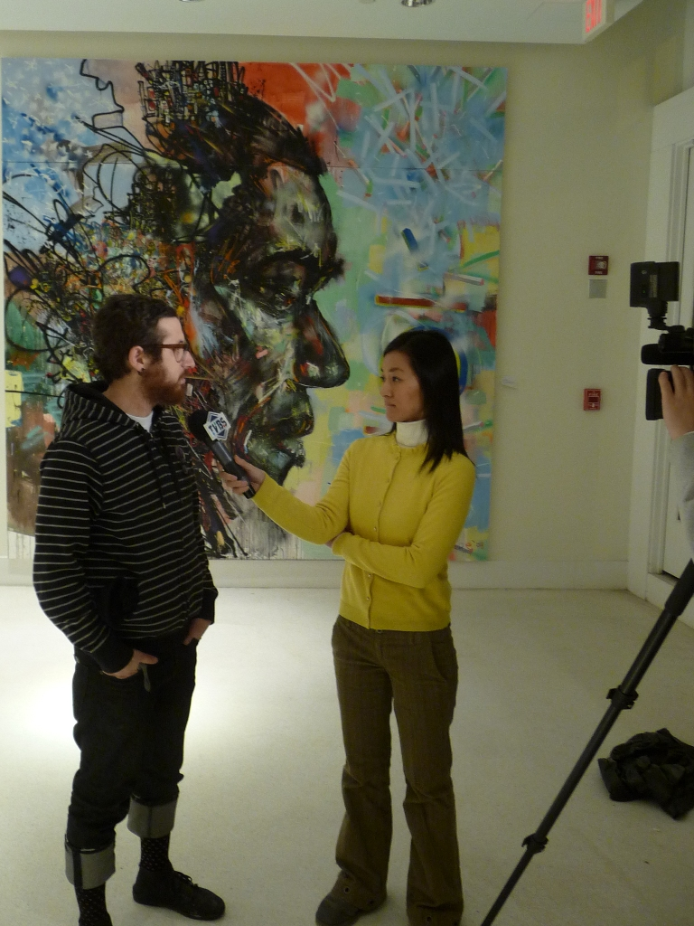 Yosi interviewing with TVBS in front of the David Choe