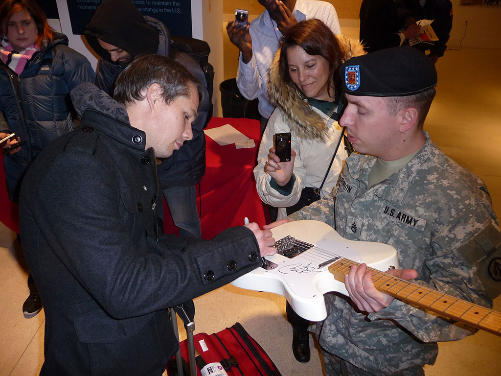 Shepard chatiting & signing for an active army soldier