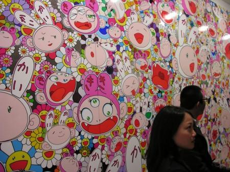 3 panel mural of Kaikai, Kiki, on his signature Flower background