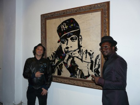 Will.i.am & Mr. Brainwash in front of Jay Z tribute.