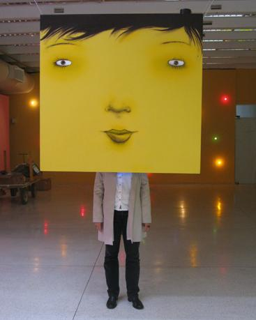Another signature Osgemeos head installation