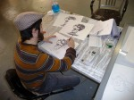 The assistant is inking the each animation drawing.
