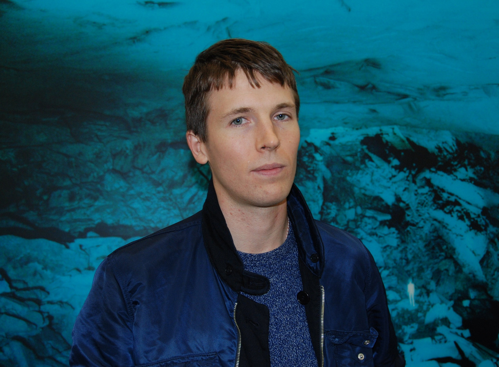 "Mr. Ryan McGinley posing in front of ""Blue Breakdown"""