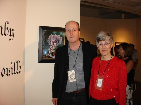 Mr. and Mrs. James Gurney in front of his painting at the Riverside Art Museum
