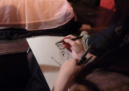 Molly Crabapple hard at work...
