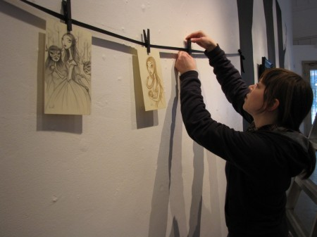Krista hanging her sketches