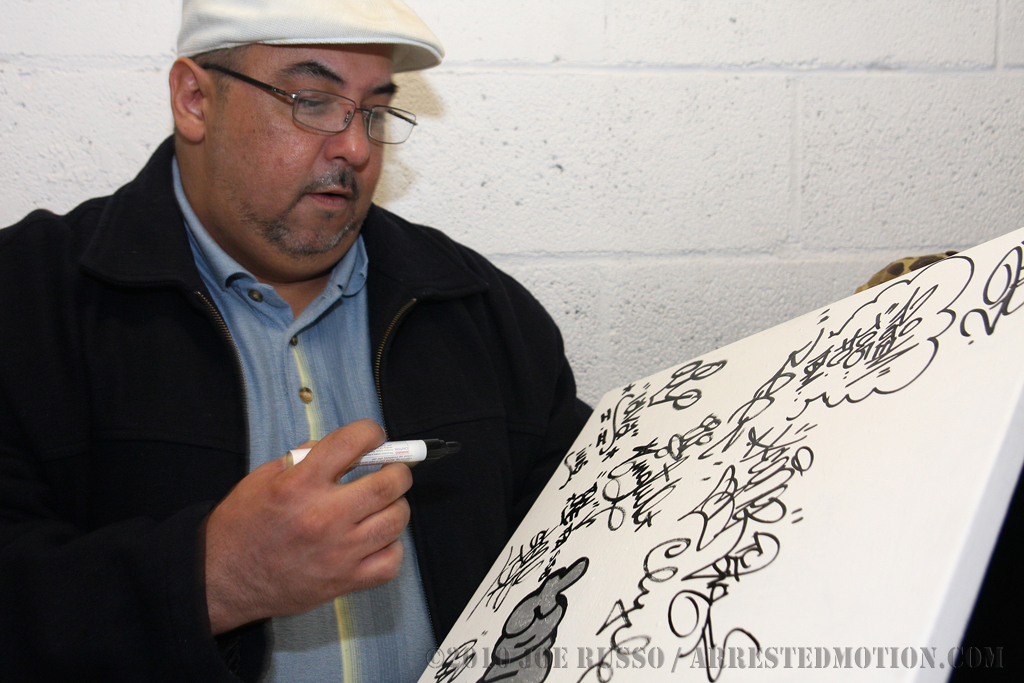 Old schoolers tagging a canvas.