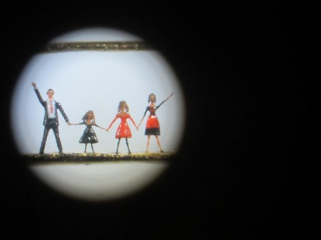 The Obama Family drawn on a pin head using a microscope to see.