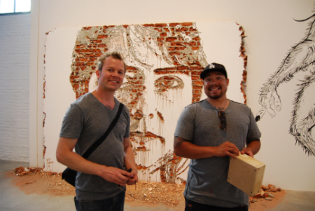 Seth Carmichael and Dan Flores, Shepard Fairey's assistant, in front of Vhils' new piece.