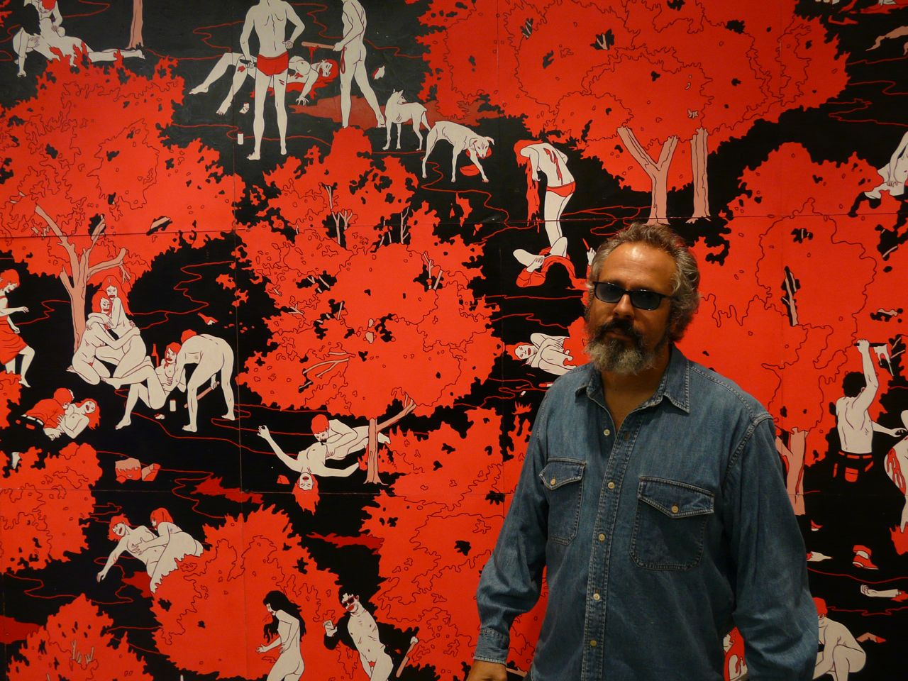 Gary Baseman in front of Cleon Peterson painting