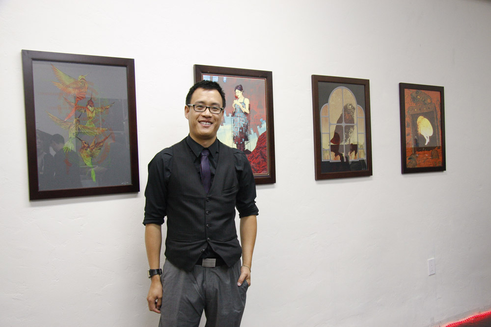 02-kevin-tong-in-front-of-his-work