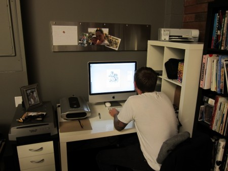 Greg works to put the touches on ONE version of the book cover