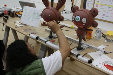 Takashi hand paints the clay figures