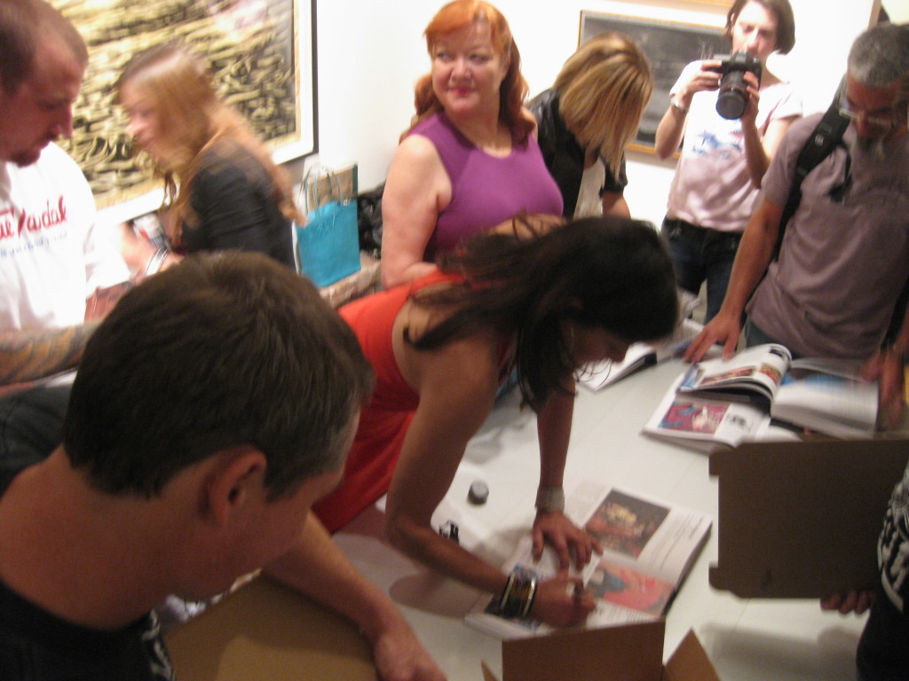 Shepard Fairey, Saber and Marsea Goldberg signing as Patti Astor looks on