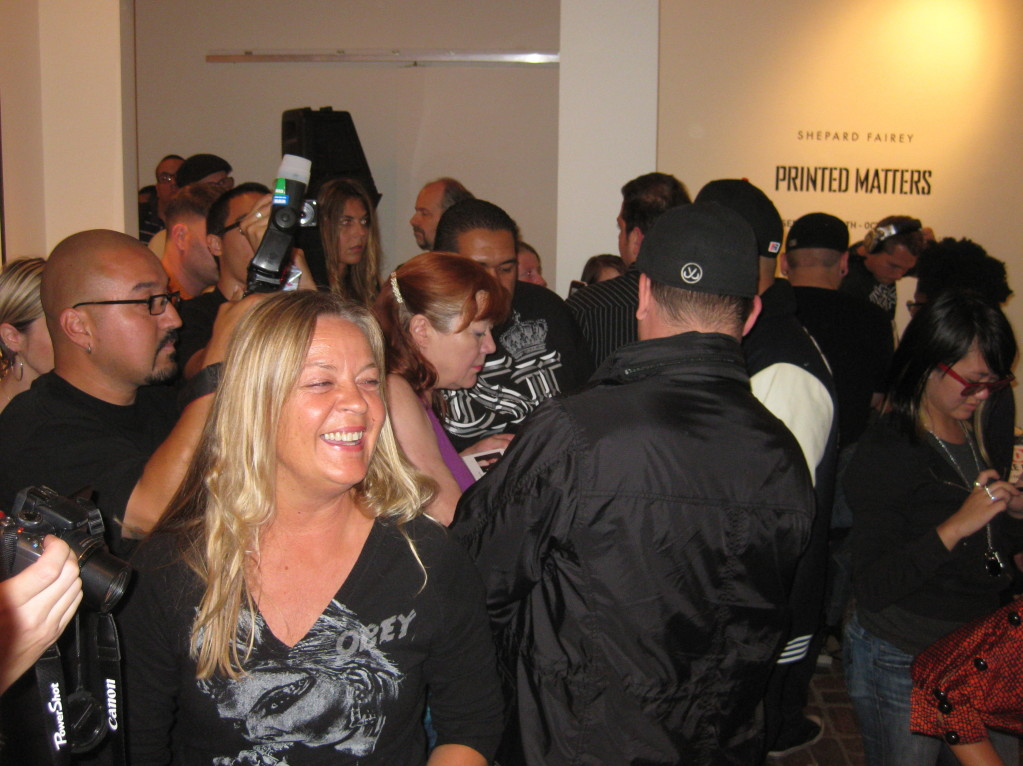Studio Number One's Tina Soikkeli, with Patti Astor in the crowd signing books and DJ Diabetic in the background