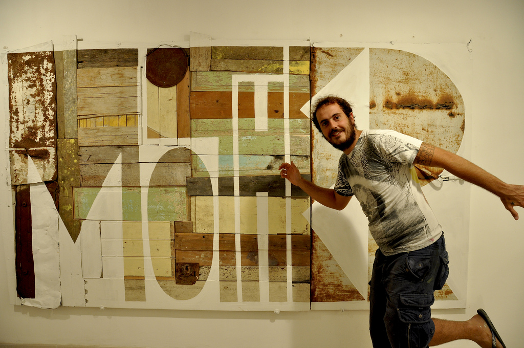 Angelo in front of Word to Mother painting
