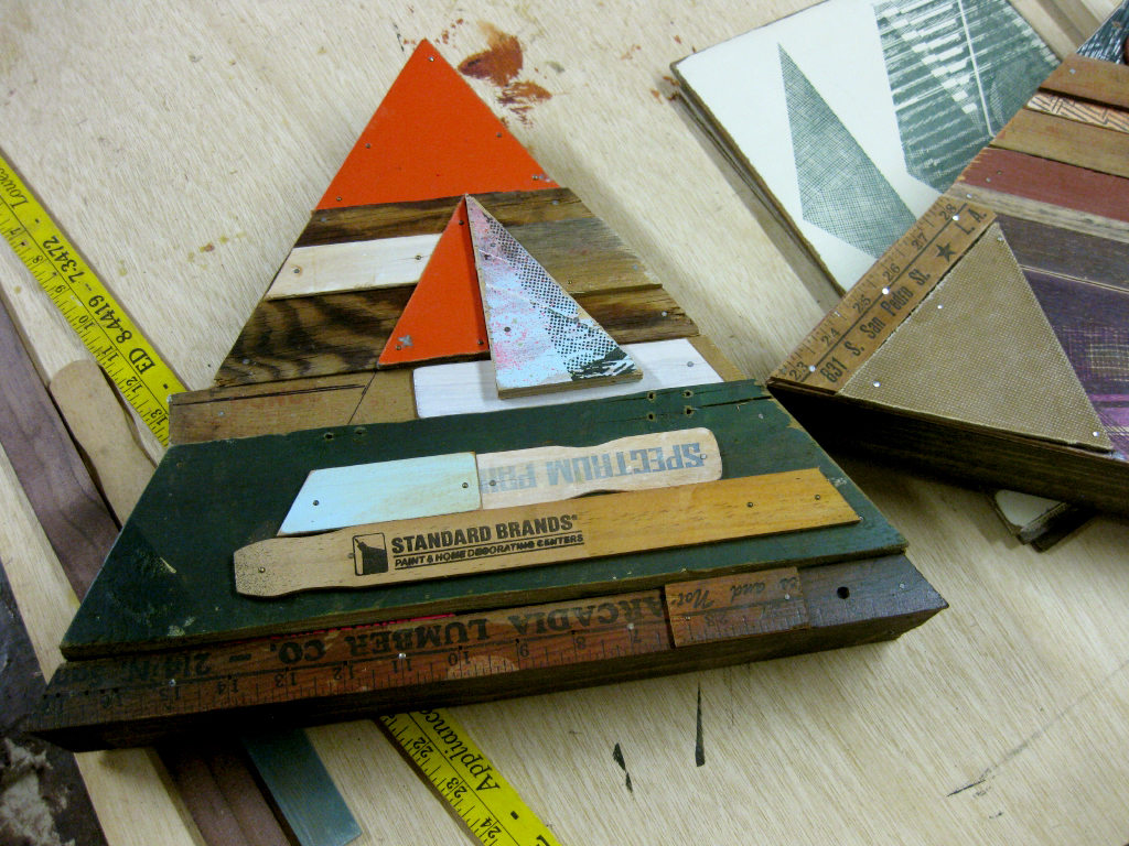 One of Kofie's triangle sculptures made from reclaimed wood