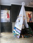 Upstairs: 'Left to My Own Devices' (left) and 'Misfit (Salvation)' (right) framing a teepee-like installation