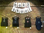 'bak-2-skool'. 2008. School ties and badges on stab vests
