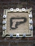 'Gun'. 2005. Spraypaint on chainmail and Kevlar, 9mm bullets