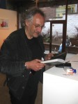Peter Kennard signing a copy of his book, '@earth'
