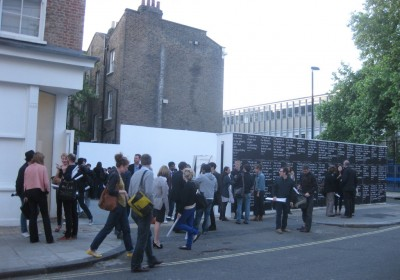 Outside 29 Bell Street as the exhibition preview draws to a close. Many of the visitors are holding posters of quotes by Ai (also pasted along the courtyard wall) distributed by Lisson Gallery on the night.