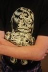 Superfan sporting a COOPxNagNagNag Violent Caveman Mishka shirt