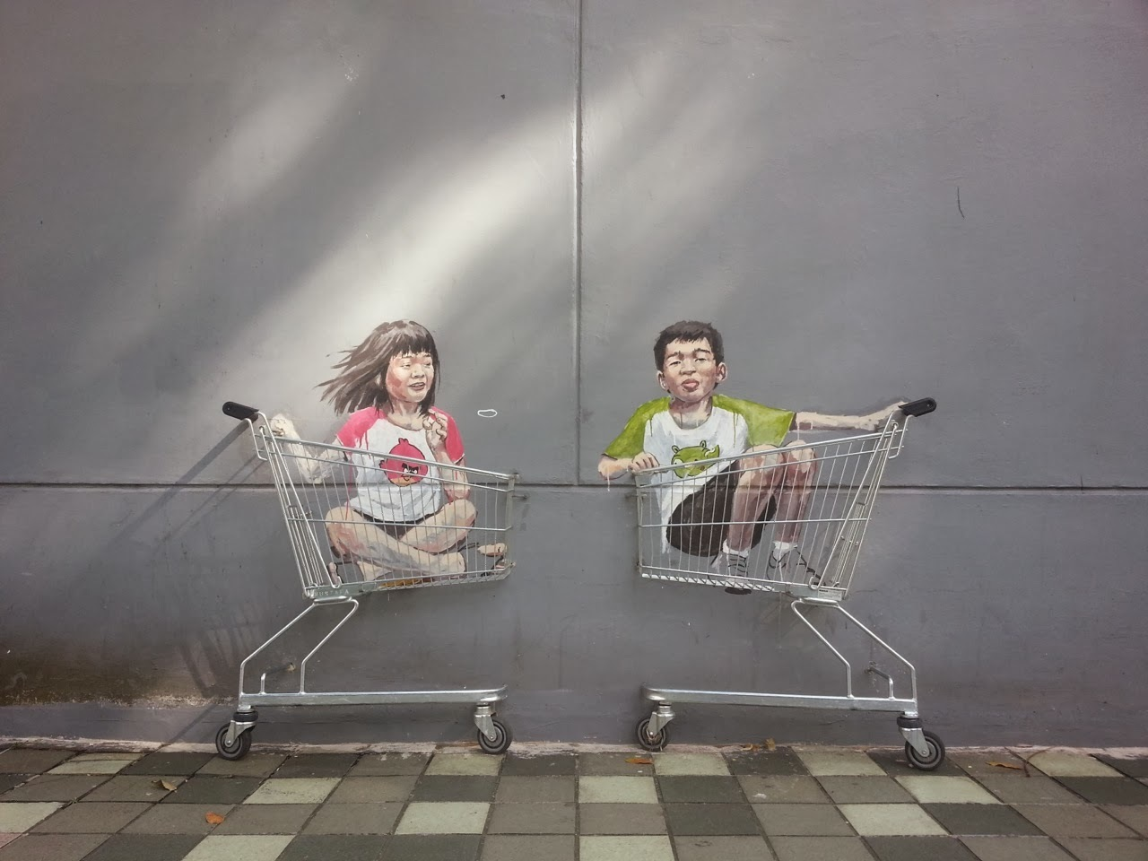 Ernest Zacharevic in Singapore. Photo via StreetArtNews.