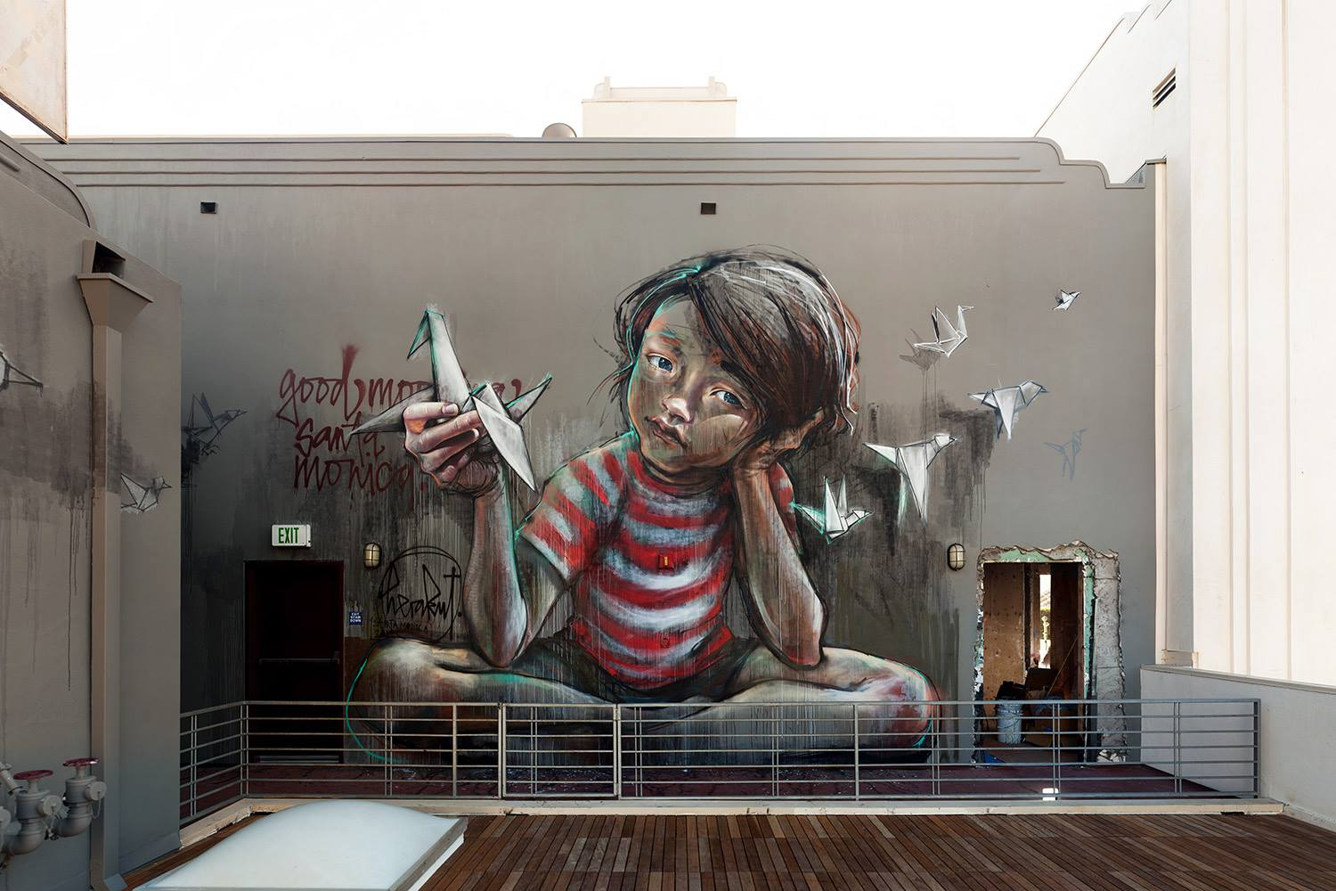 Herakut with a rooftop mural in Santa Monica.