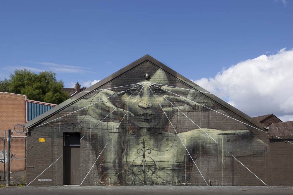 """Faith47  - """"Oh the miracle of empty hands"""" in Glascow for 'in common' commonwealth games project by recoat. Photo by Mateusz Sleczka."""