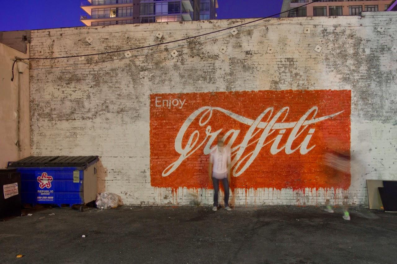 Ernest Zacharevic in Los Angeles. Photo via StreetArtNews.