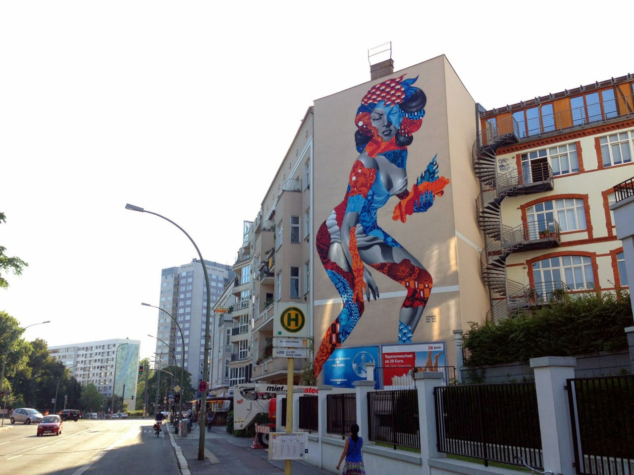 Tristan Eaton in Berlin for the One Wall project. Photo via StreetArtNews.