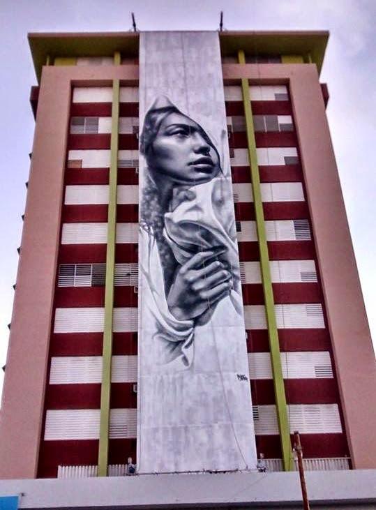 El Mac for the Los Muros Hablan Street Art Festival in Puerto Rico. Photo via StreetArtNews.