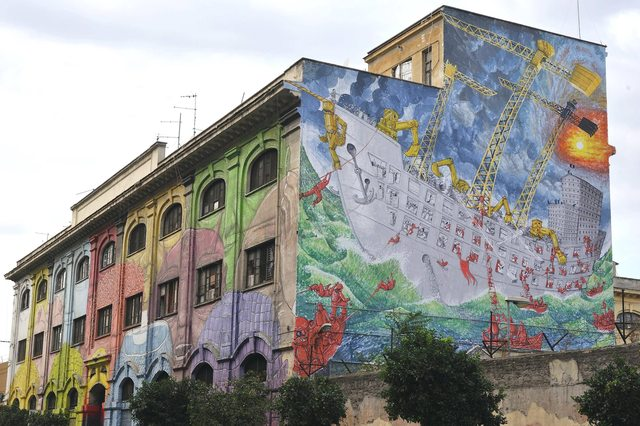 Another side of the building that Blu painted in Rome.