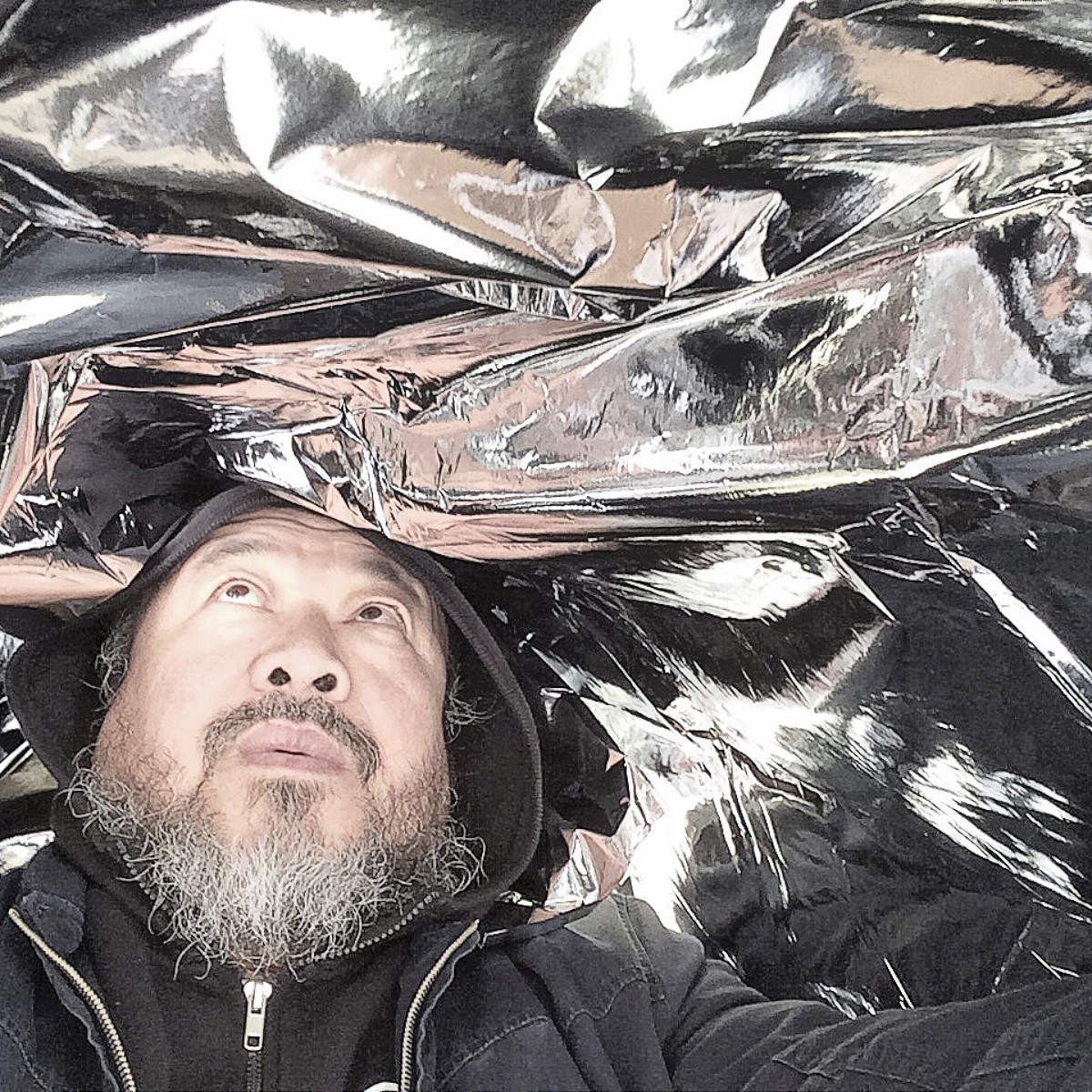 Ai WeiweiChinese 1957–Ai Weiwei with Andy Warhol's Silver Clouds, @aiww, Instagram, 2015Ai Weiwei Studio© Ai Weiwei; Andy Warhol artwork ©2015 The Andy Warhol Foundation for the Visual Arts, Inc./ARS, New York. Licensed by Viscopy, Sydney. EXHI034173