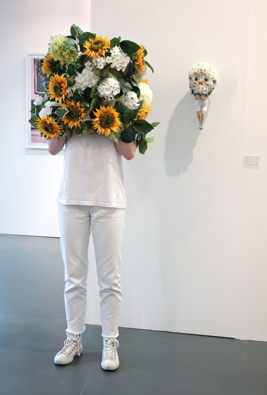 Left: Human model with headwear; Right: Yoshiyuki Ooe, 'Flower Head #3', 2015, Mixed media, H40 x W20 x D22 cm, Tezukayama Gallery (Japan)