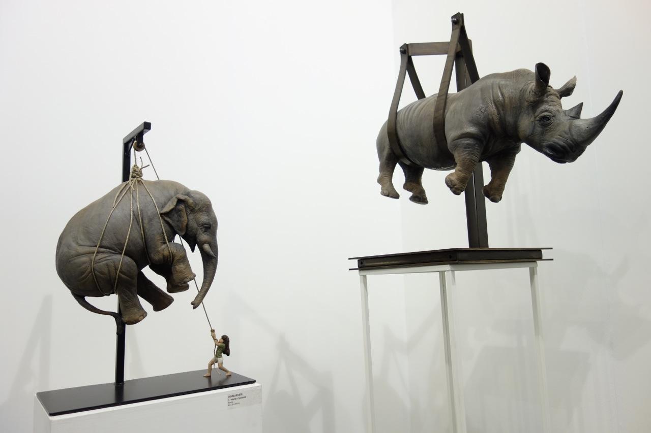 Stefano Bombardieri—Two sculptures, left to right: 'Marta e l'elefante', Bronze, H69 x L50 x D25 cm; and 'Il Peso Del Tempo Sospeso / Rhino', Bronze, H79 x L70 x D40 cm, Galerie Mark Hachem (France / Lebanon / USA)