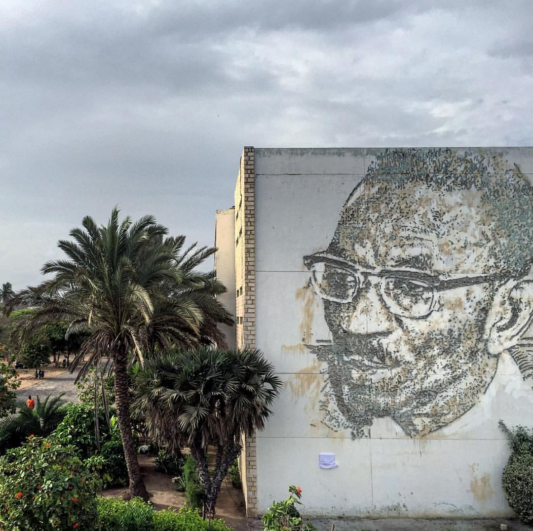 Vhils in Dakar, Senegal, with new wall depicting the physicist, historian, and anthropologist Cheikh Anta Diop (1923 – 1986).